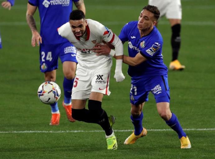 3-0. El Sevilla golea a un Getafe con diez en partido con lesión de Ocampos