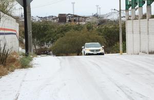 Retan automovilistas  Pavimento congelado en Monclova