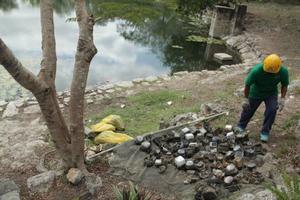 Hallan en cenote de Yucatán cerca de 95 medidores de luz